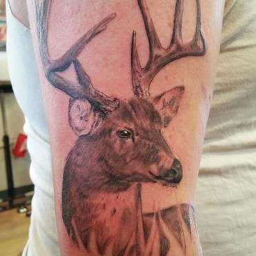 Photorealistic deer tattoo by tattoo artist Darl Papple in Michigan