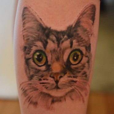 cat tattoo green eyes