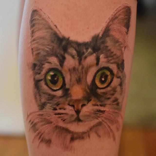 cat tattoo green eyes