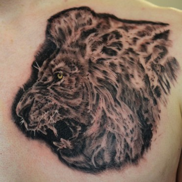 lion profile tattoo