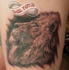 Realistic lion tattoo. Gentle lion tattoo. Beautiful lion tattoo.