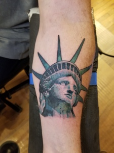 Statue of Liberty tattoo by Darl Papple