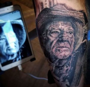 Willie Nelson portrait tattoo by Darl Papple from The Shop in Fowlerville